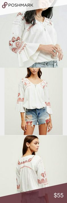 Free People Chiquita peasant top L Vintage-inspired peasant top featuring beautiful embroidery and lace-up neckline. Crochet detail at the shoulders and sweet bell sleeves. Elastic hem makes for an easy, effortless fit.  100% Cotton 40% Modal Machine Wash Cold Import Size L  NWOT, never worn or washed. Free People Tops Blouses