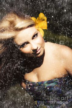 Beauty In Grunge, a dark grungy portrait of a beautiful young woman with a flower in her hair dancing in the rain by Ryan Jorgensen