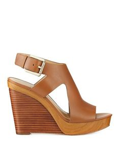Michael Kors® Josephine Wedge. Genuine leather upper. Halo-style ankle strap with adjustable buckle closure. Slip-on design. Open-toe silhouette. Soft synthetic lining. Lightly cushioned footbed with embossed brand name logo. Wrapped wedge heel and platform. Durable rubber outsole. Imported. Measurements: Heel Height: 4 1⁄4 in Platform Height: 1 1⁄4 width M. Color Luggage Vachetta Size 7.5 Brand new only tried on but never worn out. Box not included Retail $130 Check out my closet for other… Michael Kors Sandals, Tan Wedges, Wedge Heels, Neiman Marcus, Open Toe, Ankle Strap, Luxury Fashion, Platform, Slip On