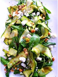 zucchini salad with herbs, feta cheese, toasted nuts, and light vinaigrette