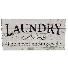 """The Wash Dry Fold Framed Sign is made of painted and distressed wood and features the words """"Wash,"""" """"Dry,"""" and """"Fold"""" separated by star symbols. The sign measures high by wide and comes with two metal hangers. This would be a cute diy for laundry room"""