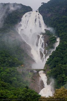 Dudhsagar waterfall on the border of Goa and Karnataka in India are four tiered waterfalls resembling a cascading fall of milk. Beautiful Places To Visit, Wonderful Places, Beautiful World, Amazing Places, Peaceful Places, Places To Travel, Places To See, Tourist Places, Places Around The World