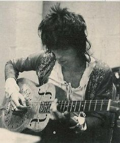 Keith Richards playing a vintage National Steel guitar