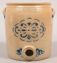 "Sold $ 850 F.H. Cowden, Harrisburg, (PA) Stencil Decorated 2 Gallon Stoneware Water Cooler. Circa. 1881-1888. Cobalt blue geometric and scroll stencilled design. Molded rim, straight sided and applied ear handles. Accompanied with a period wood and pewter tap. 10 1/4"" high. Condition: Good with spider lines"