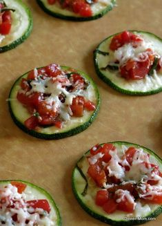 Fresh tomatoes, basil, garlic, balsamic vinegar and a sprinkle of cheese top roasted zucchini in this easy Zucchini Bruschetta snack or appetizer.