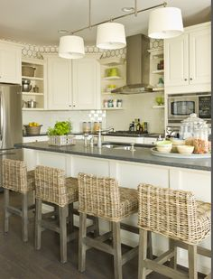 Small graphic design over counters.   bar stools & kitchen finishes.