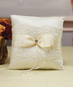 The delicate lace embellishments and satin bow make this Ring Pillow a perfect accessory to any whimsy wedding ceremony.     Size:   17.75cm x 17.75cm