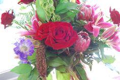 roses, protea, scabiosa daisy, lily's