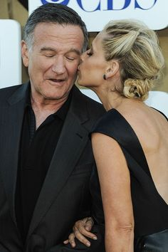 Robin Williams: A Life In Pictures With Sarah Michelle Gellar at the CBS/CW/Showtime Summer TCA Party in Los Angeles in 2013 (left), and at the 2012 Comedy Awards in New York.
