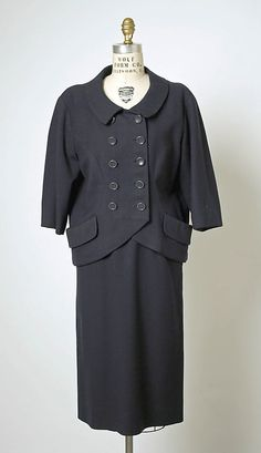 Suit.  House of Balenciaga (French, founded 1937).  Designer: Cristobal Balenciaga (Spanish, 1895–1972). Date: spring/summer 1951. Culture: French. Medium: wool. Dimensions: Length at CB (a): 24 1/2 in. (62.2 cm). Length at CB (b): 27 in. (68.6 cm).