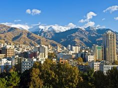 Tehran, the nation's capital city, is surrounded by snowy mountains.