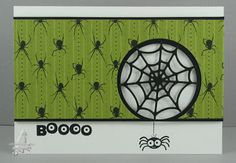 Halloween card...very elegant look, but EEK!!...spiders all over in diamond pattern...especially like the black spider web die cut filling in the circle...green and white card with black accents...