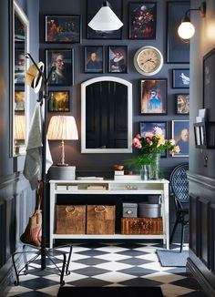 A small grey hallway with a white console table and a mirror. Shown together with a hat and coat stand in black steel.