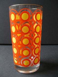 Vintage ORANGE MOD drinking glass via Etsy