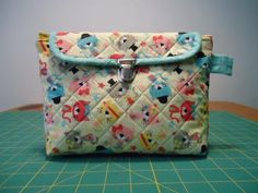 Looking for sewing project inspiration? Check out Cosmetic Bag with fold over Brush roll by member MRaquel Machado.