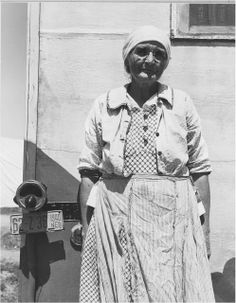 Migrant worker, age 70. Her brother, sister and nephew work alongside her.  Depression era photo by Dorothea Lange.