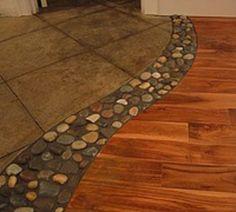 River rock in between wood and tile floors