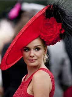 Welsh singing star Katherine Jenkins at Royal Ascot 2011 wearing a red Philip Treacy hat