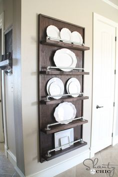 DIY Display rack... So easy! The pipes come cut and ready to go! LOVE