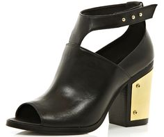 Black ankle boots with strap and gold plate heel detail