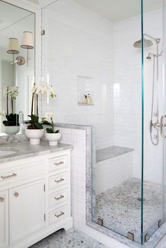 A Glass Enclosed Shower Is Fitted With A Bench Is This Traditional Master  Bathroom Space