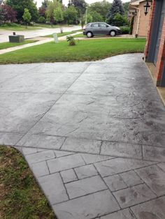 Rough Cut Stone Stamped Concrete Driveway with a Stone Block Border and Small Ashlar Slate Stamped Concrete Walkway in London Ontario