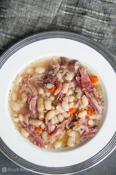 White Bean and Ham Soup on SimplyRecipes.com. Me: This looks similar to mine although my beans soak overnight and I add 1 can of Rotel tomatoes, a Bay Leaf, and a little Thyme for more seasoning.