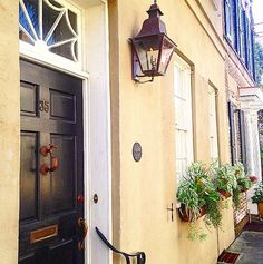 Gas lanterns and window boxes in #Charleston