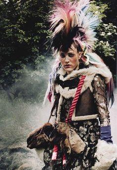 British Vogue, Wild Romance, September 2010.  Paolo Roversi - Photographer  Lucinda Chambers - Fashion Editor/Stylist  Sam McKnight - Hair Stylist  Hannah Murray - Makeup Artist  Othilia Simon - Model