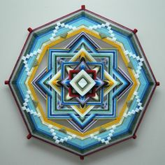 This is the first mandala I, Elizabeth Tingley, made when I was newly apprenticed to Jay Mohler in the fall of 2015. I was very excited to try out new color palettes, and I got a bit carried away with color changes. It was a joy to make this mandala and I would be happy to create it again, with any customization, for you.