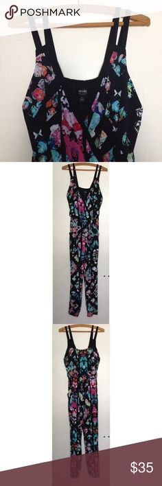 WEEKEND SALE Nicole Miller Patterned Jumpsuit This jumpsuit was worn maybe 2-3 times max and it's been sitting in my closet for a year ever since. It's in mint condition- no wear and tear, practically new. It features a plunge neckline and has a floral type pattern. It's perfect for Spring/Summer weather because the material is thin and very cool. Nicole by Nicole Miller Pants Jumpsuits & Rompers