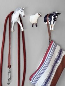 Actually,..I could imagine cutting toy animals in half and hanging them on the wall to hang things from!!  Upcycling and organisation tutorials