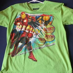 Neon Green Marvel Shirt Kids sized Large is a adult Medium. Worn a few times but it's in prefect condition there's no cracks in the print at all.  Wolverine.  Iron Man. Spiderman. Marvel Tops Tees - Short Sleeve