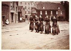 Five female fish-gutters, Whitby, North Yorkshire, c 1905. Frank Meadow Sutcliffe