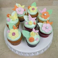 Mint green cupcakes with flowers and butterflies by Cakes Sweets and Treats