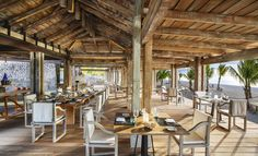 Plan a getaway at The St. Regis Mauritius Resort, a luxury hotel offering luxury accommodations, an idyllic beach, spa and more in the South West of Mauritius. Woods Restaurant, Restaurant Photos, Mauritius Resorts, Beach Cafe, Fine Hotels, Beach Wood, Les Themes, Hotel Reservations, Luxury Accommodation