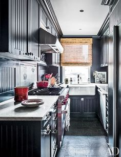In the kitchen of Alexa Hampton's New York City home, cabinetry by S. Donadic is painted a Benjamin Moore black. | archdigest.com