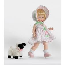 "Mary Had a Little Lamb. $63.96 Isn't she sweet? Mary Had a Little Lamb is an adorable 8"" doll with short blonde hair. She comes dressed in a cute pink and white dress accented with pink and green bows, pink shoes, and a matching bonnet. She comes with her lamb. What a perfect first collectable! Retired item, limited supply."