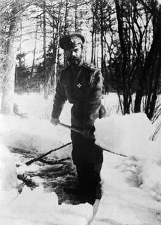 Tsar Nicholas II shoveling snow during captivity in Tsarskoe Selo