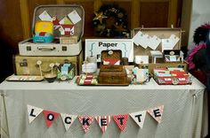 Craft Fair Table: Vintage suitcases make great ways to display retro themed goods