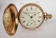 An antique 1891 Elgin full hunter pocket watch.