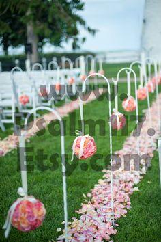 Wedding pomander flower balls line the ceremony isle on white shepherd hooks. Custom pomanders: www.Psalm117.Etsy.com