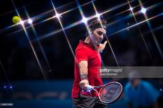 Roger Federer of Switzerland in action in his match against Milos Raonic of…