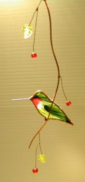 Hummingbird Stained Glass Suncatcher by BirdsAndBugs1 on Etsy.