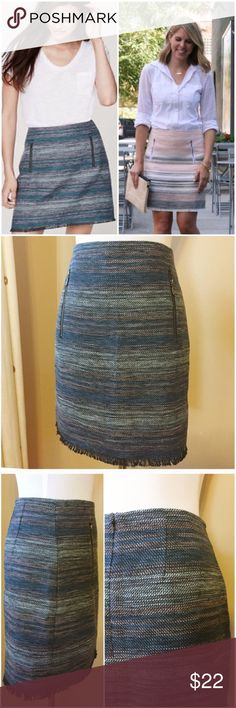 """Ann Taylor Loft Blue Tweed Fringe Pencil Skirt 6 Ann Taylor Loft Blue Tweed Fringe Pencil Skirt Zipper Pockets  • Size 6 • 15"""" waist (measured flat) • 19"""" hips • 18.5"""" length • Seriously special tweed striped skirt in steel blue, dark gray, blue gray, light blue • Two exposed zipper functional pockets at waist • Fully lined • Back zipper with hook and eye closure • 64% polyester 36% cotton shell • Very good pre-loved condition, gently worn, no imperfections LOFT Skirts Pencil"""