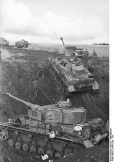 German Panzers maneuver during the Battle of Kursk, July 1943. Kursk still remains the biggest tank battle in history. The Germans lost and the Soviets joined their relentless advance that brought them to Berlin.