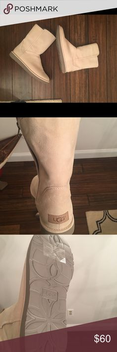 Uggs Winter white short ugg boots. Worn once in the house for a few hours. I was told in store that these are waterproof....... but I didn't get any documentation to support that. UGG Shoes Winter & Rain Boots