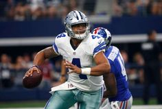 Dallas Cowboys quarterback Dak Prescott (4) scrambles out of the pocket under pressure from New York Giants' Dominique Rodgers-Cromartie (41) in the first half of an NFL football game, Sunday Sept. 11, 2016, in Arlington, Texas.