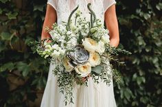Lush Wedding Bouquet Which Includes: White English Garden Roses, White Veronica, White Delphinium, White Snapdragons, Green Succulents, Several Varieties Of Greenery & Foliage