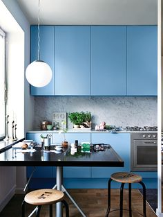 Again, generally like this kitchen (blue against the stainless steel appliances), but do not like the black table/stools nor the light fixture